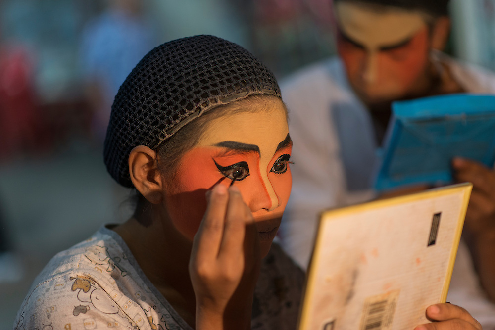 The Teochew Chinese Opera troupe prepare for a performance in Bangkok's Chinatown.