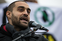 London, UK. 11 January, 2020. Rapper Lowkey addresses the No War on Iran demonstration in Trafalgar Square organised by Stop the War Coalition and the Campaign for Nuclear Disarmament to call for deescalation in the Middle East following the assassination by the United States of Iranian General Qassem Soleimani and the subsequent Iranian missile attack on US bases in Iraq.