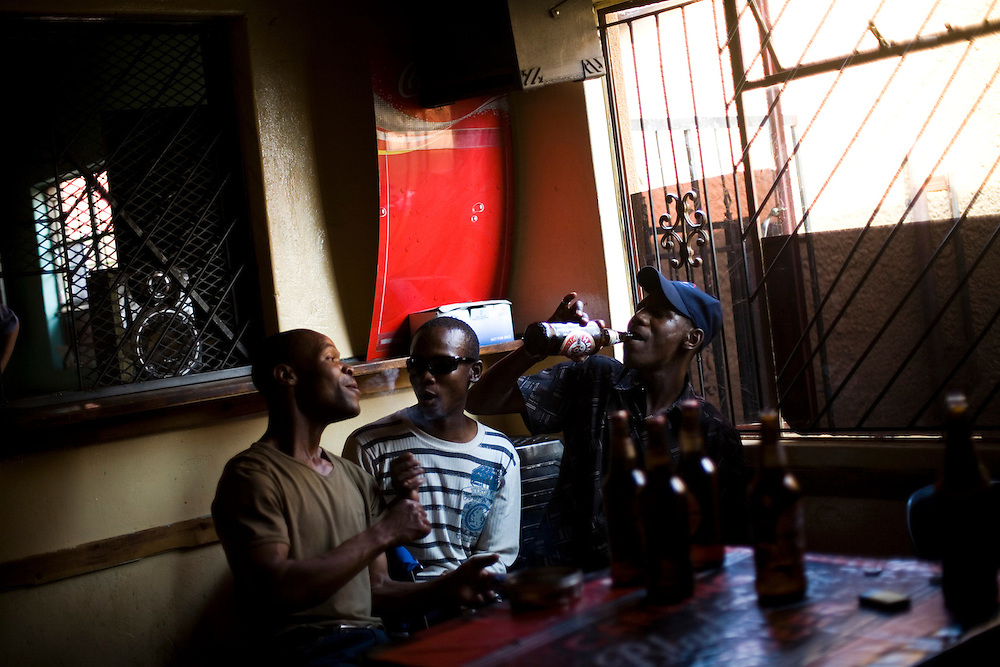 Inside a tavern in Khutsong, a poor mining community outside of Johannesburg.    Once a miner has contracted TB the disease can lie in wait for more than 10 years until the patients immune system is weakened and the disease becomes active.  South African Gold miners are particularly vulnerable to contracting TB because of the small, poorly ventilated work conditions, high rates of TB and high rates of silicosis, a lung disease often found in miners that increases the chance of catching TB.