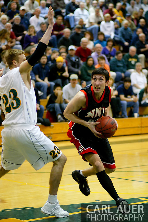 1/13/2006: Dato Sakvarelidze of the Northwest Nazarene University Crusaders heads to the hoop in the Alaska Anchorage comeback victory over Northwest Nazarene, 60-57, in men?s basketball action at the Wells Fargo Sports Complex on Saturday.