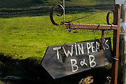 Rusty, broken Sign: Twin Peaks bed and breakfast,Fisher Street, Doolin, Co. Clare, Ireland