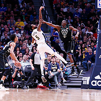 01 April 2018: Denver Nuggets forward Will Barton (5) takes a jump shot over Milwaukee Bucks guard Tony Snell (21) during the Denver Nuggets 128-125 victory over the Milwaukee Bucks, at the Pepsi Center, Denver, Colorado, USA.