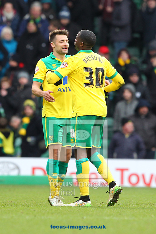 Russell Martin of Norwich and Sebastien Bassong of Norwich celebrate victory at the end of the Sky Bet Championship match at Carrow Road, Norwich<br /> Picture by Paul Chesterton/Focus Images Ltd +44 7904 640267<br /> 21/03/2015