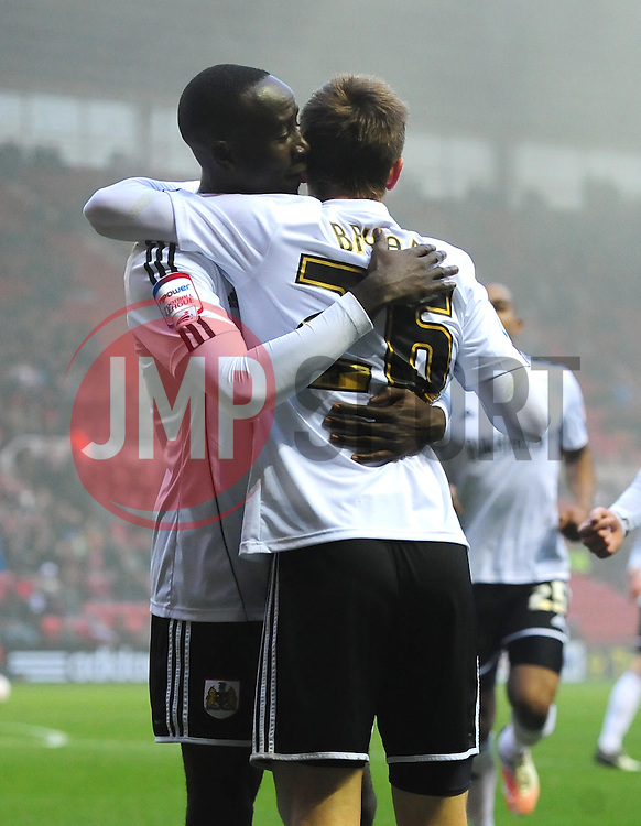 Bristol City's Albert Adomah celebrates with Bristol City's Joe Bryan after Bryan's cross led to Adomah's goal - Photo mandatory by-line: Joe Meredith/JMP  - Tel: Mobile:07966 386802 24/11/2012 - Middlesbrough v Bristol City - SPORT - FOOTBALL - Championship -  Middlesbrough  - River Side Stadium
