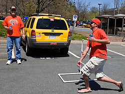 Brandon Moore (right) plays tailgate golf while his father Charles Moore watches before the UVA spring game.  The Virginia Cavaliers football team played the annual spring football scrimmage at Scott Stadium on the Grounds of the University of Virginia in Charlottesville, VA on April 18, 2009.  (Special to the Daily Progress / Jason O. Watson)