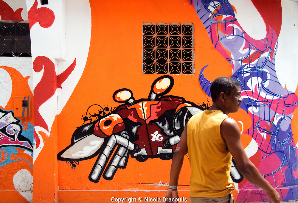 AfroReggae bring colour and vibrancy to their community streets by asking graffiti artists paint their buildings. Vigario Geral, Rio De Janeiro, September 2006