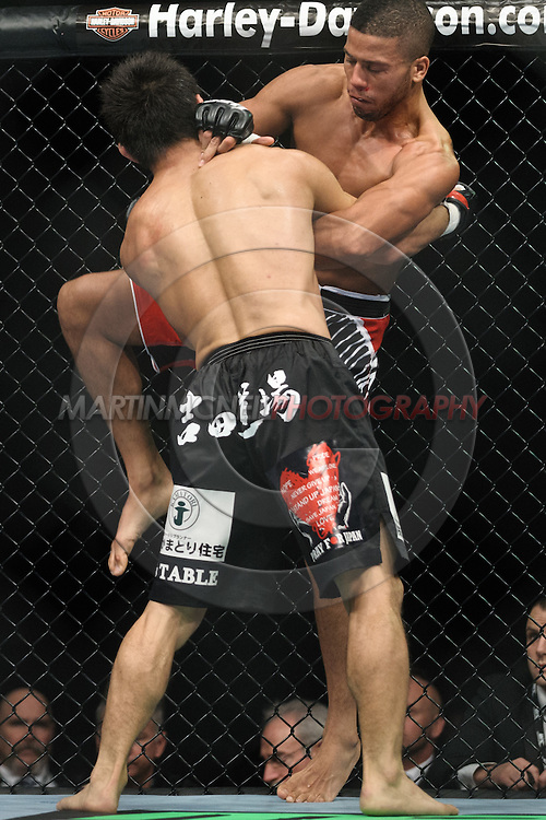 "BIRMINGHAM, ENGLAND, NOVEMBER 5, 2012: Jason Young (facing) grapples with Michihiro Omigawa during ""UFC 138: Munoz vs. Leben"" inside the National Indoor Arena in Birmingham, United Kingdom"
