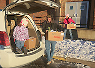 Grace Bruns (from left), 5, of Fairfax, Jim Berger, and Sue Berger, of Cedar Rapids load food boxes in their minivan as the Society of St. Vincent de Paul delivers 237 holiday meals to families in Cedar Rapids, Marion, and Hiawatha from the St. Wenceslaus Church gym at 1230 5th St SE in Cedar Rapids on Saturday morning, December 22, 2012. (Stephen Mally/Freelance)