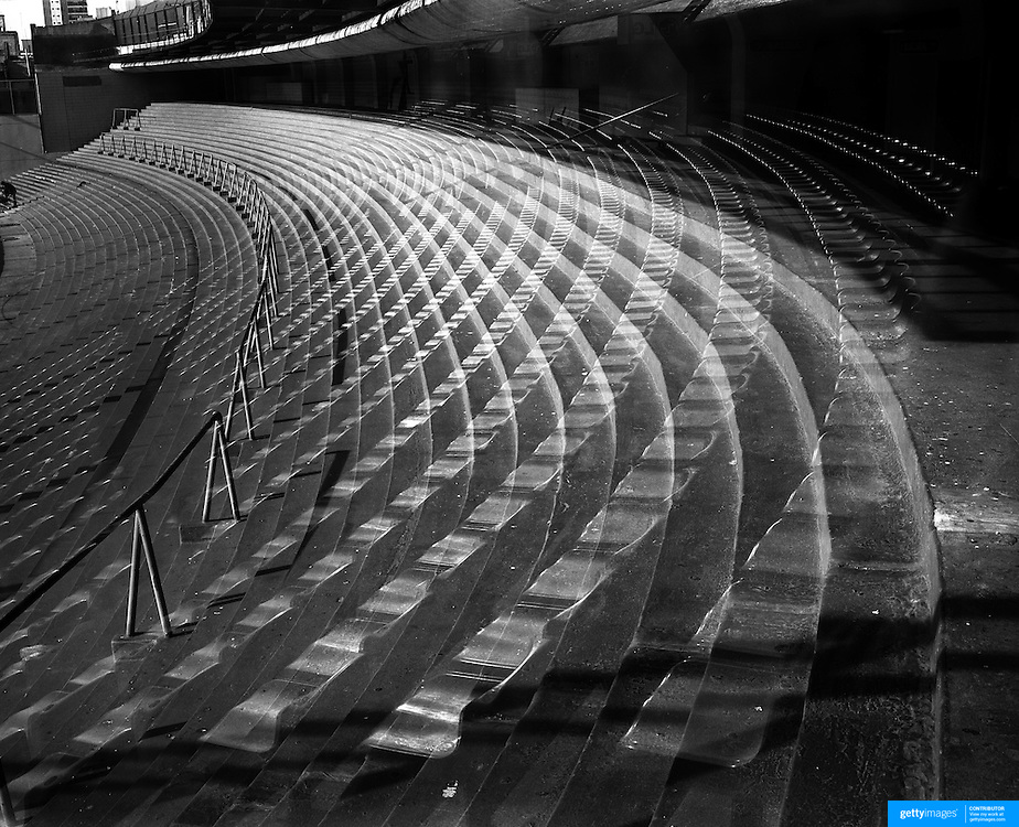 Playing with Ghosts... Football Stadiums of Argentina..Argentina, one of the powerhouses of World Football is steeped in history and tradition, so too are the countries stadiums. Many were built in the early part of the 1900's and maintain an incredible unique atmosphere of their own. Empty stadiums terraces sing to the observer, holding onto the fans voices from match days past when Argentina's fans show a passion for the game and their clubs which is second to none. The historic stadiums have a voice of their own and a unique atmosphere.<br /> <br /> Seats are reflected in a plastic panel separating the standing and seating area's of Argentina's most famous stadium Estadio Alberto J. Armando, otherwise know as La Bombonera, home of Club Atlético Boca Juniors  based in the La Boca neighbourhood of Buenos Aires. The ground was opened May 25, 1940 and has a capacity of 49,000.