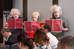 © Licensed to London News Pictures. 10/06/2016. LONDON, UK.  Labour Party suporters wearing Boris Johnson masks hold Brexit Budget documents highighting how a Conservative Brexit Budget would look if the UK were to vote to leave the European Union (EU) in a referendum during a speech by Tom Watson, Yvette Cooper and Angela Eagle. The Labour Party analysis warns of the implications a Brexit Budget would have on public services and family finances, including the introduction of more than £18bn in social security cuts and tax rises.  Photo credit: Vickie Flores/LNP