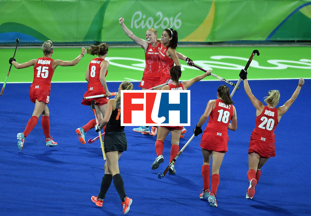 Britain's Nicola White (C L) celebrates with teammate Britain's Sam Quek (C R) after scoring a goal during the women's Gold medal hockey Netherlands vs Britain match of the Rio 2016 Olympics Games at the Olympic Hockey Centre in Rio de Janeiro on August 19, 2016. / AFP / Pascal GUYOT        (Photo credit should read PASCAL GUYOT/AFP/Getty Images)