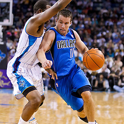 November 17, 2010; New Orleans, LA, USA; Dallas Mavericks point guard Jose Juan Barea (11) drives past New Orleans Hornets point guard Chris Paul (3) during the first half at the New Orleans Arena. Mandatory Credit: Derick E. Hingle