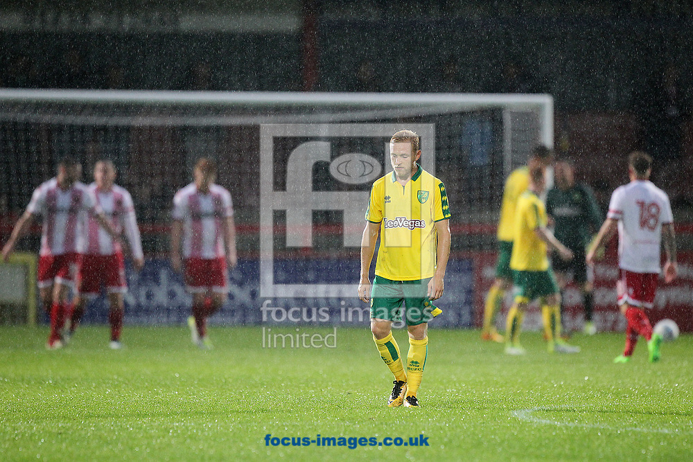 Alex Pritchard of Norwich looks dejected as the Stevenage players celebrate their side&rsquo;s 2nd goal during the Pre-season Friendly match at the Lamex Stadium, Stevenage<br /> Picture by Paul Chesterton/Focus Images Ltd +44 7904 640267<br /> 11/07/2017