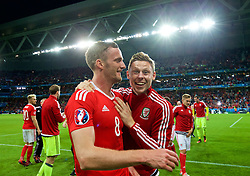 LILLE, FRANCE - Friday, July 1, 2016: Wales' Andy King and Simon Church celebrate a 3-1 victory over Belgium and reaching the Semi-Final during the UEFA Euro 2016 Championship Quarter-Final match at the Stade Pierre Mauroy. (Pic by David Rawcliffe/Propaganda)