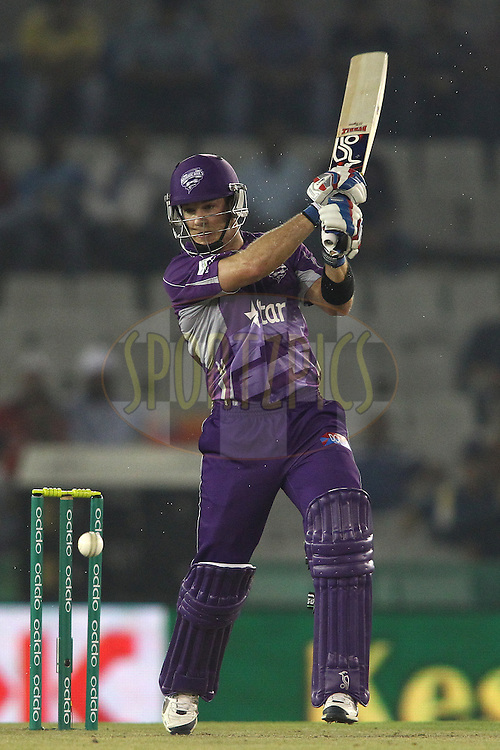 Hobart Hurricanes captain Tim Paine plays a delivery towards the covers during match 2 of the Oppo Champions League Twenty20 between the Kings XI Punjab and the Hobart Hurricanes held at the Punjab Cricket Association Stadium, Mohali, India on the 18th September 2014<br /> <br /> Photo by:  Shaun Roy / Sportzpics/ CLT20<br /> <br /> <br /> Image use is subject to the terms and conditions as laid out by the BCCI/ CLT20.  The terms and conditions can be downloaded here:<br /> <br /> http://sportzpics.photoshelter.com/gallery/CLT20-Image-Terms-and-Conditions-2014/G0000IfNJn535VPU/C0000QhhKadWcjYs
