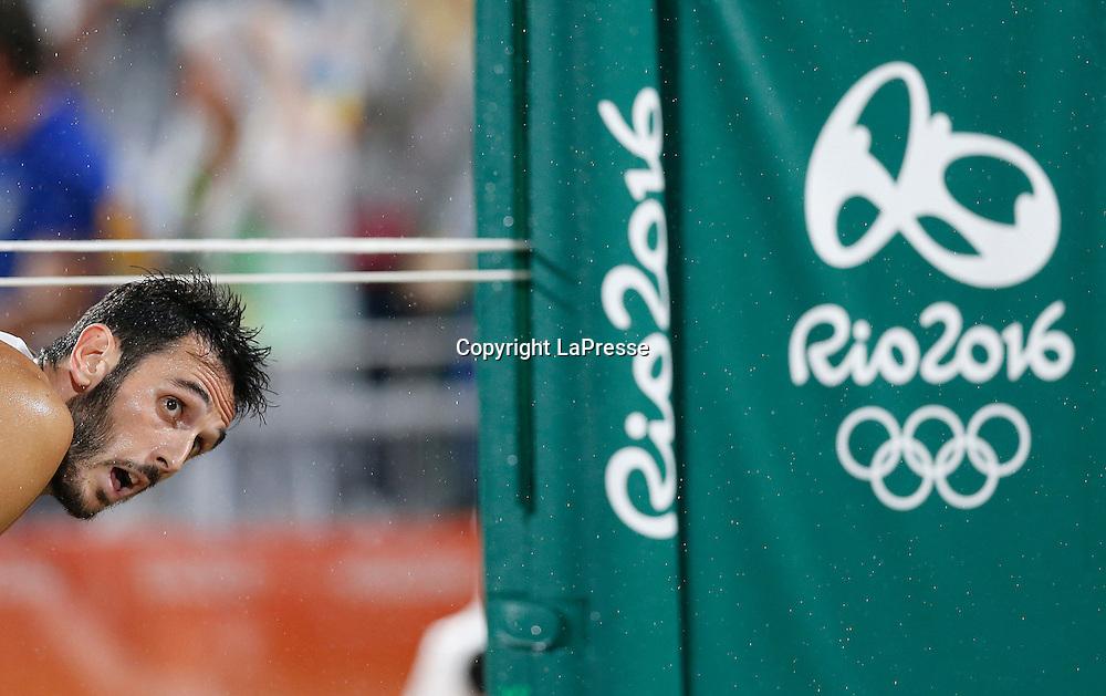 Foto LaPresse - Spada<br /> 19  agosto  2016 , Rio de Janeiro ( Brasile)<br /> Sport <br /> Olimpiadi Rio 2016 - Finale Beach Volley uomini <br /> P. Nicolai e D. Lupo ( ITA ) vs B. Schmidt e A. Cerutti ( BRA )<br /> Cerimonia di premiazione <br /> Nella foto:   P. Nicolai  ( ITA )  <br /> <br /> Photo LaPresse - Spada<br /> August 19 ,  2016  , Rio de Janeiro 2016  (Brazil)<br /> Sport<br /> Olympic games Rio 2016 - Men's beach volleyball final <br /> P. Nicolai e D. Lupo ( ITA ) vs B. Schmidt e A. Cerutti ( BRA )<br /> Winning ceremony<br /> In the pic:   P. Nicolai  ( ITA )