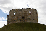 Clifford's Tower, York, UK, which is set on a tall mound in the heart of Old York. This imposing tower is almost all that remains of York Castle, which was originally built by William the Conqueror.