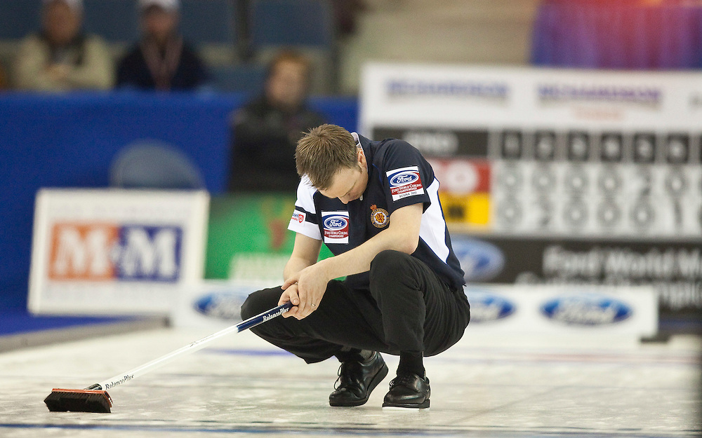 Scottish skip Tom Brewster hangs his head after missing a shot during Scotland's 5-2 loss to Canada in the 1-2 playoff match at the Ford World Men's Curling Championships in Regina, Saskatchewan, April 8, 2011.<br /> AFP PHOTO/Geoff Robins
