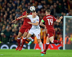 LIVERPOOL, ENGLAND - Tuesday, April 24, 2018: Liverpool's Virgil van Dijk and AS Roma's Edin Džeko during the UEFA Champions League Semi-Final 1st Leg match between Liverpool FC and AS Roma at Anfield. (Pic by David Rawcliffe/Propaganda)