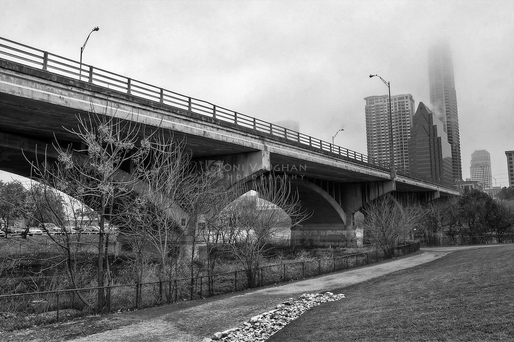 Foggy morning in Austin. Congress Avenue Bridge spans Lady Bird Lake in Austin, Texas.