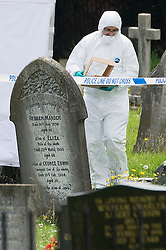 © London News Pictures. 10/07/2012. Writtle, UK. Forensics carrying an evidence box at the scene where the body of 64 year-old Peter Reeve was found in the graveyard at All Saints CHurch in Writtle, Essex on July 10, 2012. Peter Reeve was being hunted by police in connection with the murder of Pc Ian Dibell in Clacton.  Photo credit: Ben Cawthra/LNP.