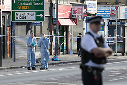 © Licensed to London News Pictures. 22/09/2016. LONDON, UK.  Police and forensic officers at the scene. A man was found dead in the street following a suspected assault, near All Saints DLR station just before midnight last night.  Photo credit: Vickie Flores/LNP