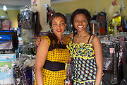 Njideka Harry (right), director of Youth for Technology, pictured with Nneka Adiele who has attended one of YFT business training workshops in Nigeria. <br /> <br /> Nneka runs a shop called 'Fantasy'. She recently attended some business training run by Youth for Technology and also signed up to recieve the business support text messages.<br /> <br /> The most important thing she learnt from the training was about innovation and branding. She finds the SMS service useful for ongoing reminders and encouragement that builds on the training.<br /> <br /> As part of her innovation strategy she has diversified her income stream and is now also selling women's clothes and accessories. Opening the shop has also helped her promote the party business to customers.