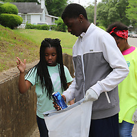 "LIBBY EZELL | BUY AT PHOTOS.DJOURNAL.COM<br /> Cayelin Richardson, 11 left, Isaiah Orr, 15, and Kameron Crayton, 13, helps clean up the Park Hill Neighborhood Saturday as a part of ""Pick it Up, Tupelo!"""
