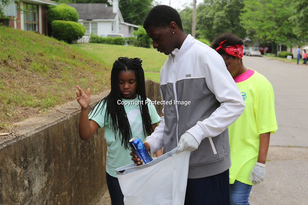 LIBBY EZELL | BUY AT PHOTOS.DJOURNAL.COM<br /> Cayelin Richardson, 11 left, Isaiah Orr, 15, and Kameron Crayton, 13, helps clean up the Park Hill Neighborhood Saturday as a part of &quot;Pick it Up, Tupelo!&quot;