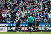 Brentford players celebrate in front of the Huddersfield fans during the Sky Bet Championship match between Huddersfield Town and Brentford at the John Smiths Stadium, Huddersfield, England on 7 May 2016. Photo by Mark P Doherty.