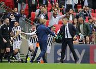 Neil Harris shakes hands with Stuart McCall after the Sky Bet League 1 play-off final win at Wembley Stadium, London<br /> Picture by Glenn Sparkes/Focus Images Ltd 07939664067<br /> 20/05/2017