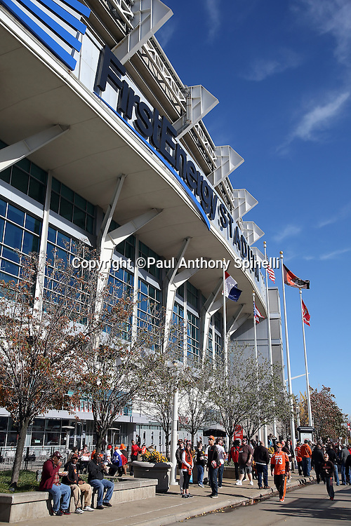 FirstEnergy Stadium stands tall in this wide angle, general view photograph taken as fans walk around the pedestrian plaza before the Cleveland Browns 2015 week 8 regular season NFL football game against the Arizona Cardinals on Sunday, Nov. 1, 2015 in Cleveland. The Cardinals won the game 34-20. (©Paul Anthony Spinelli)