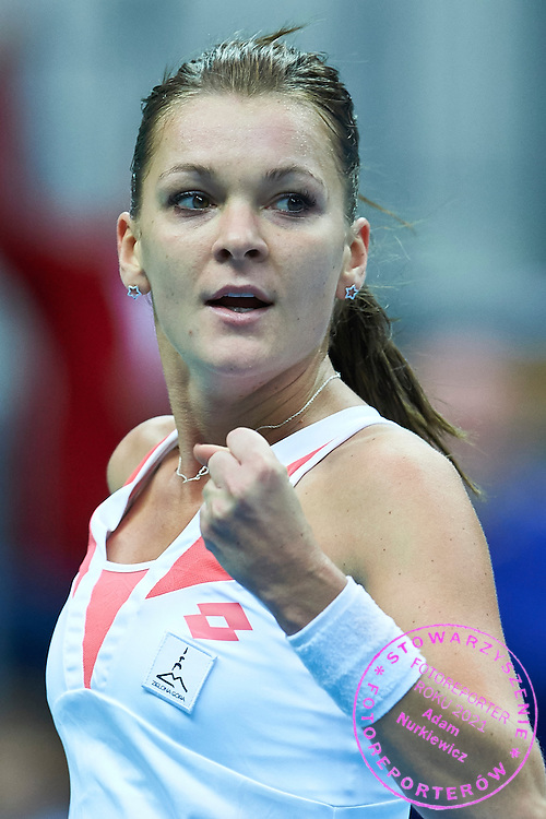 Agnieszka Radwanska of Poland celebrates after scoring during the Fed Cup / World Group Play Off tennis match between Poland and Switzerland on April 18, 2015 in Zielona Gora, Poland<br /> Poland, Zielona Gora, April 18, 2015<br /> <br /> Picture also available in RAW (NEF) or TIFF format on special request.<br /> <br /> For editorial use only. Any commercial or promotional use requires permission.<br /> <br /> Adam Nurkiewicz declares that he has no rights to the image of people at the photographs of his authorship.<br /> <br /> Mandatory credit:<br /> Photo by &copy; Adam Nurkiewicz / Mediasport