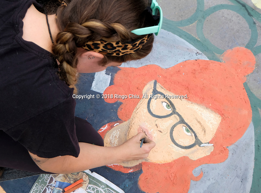 26th annual Pasadena Chalk Festival held in Los Angeles<br /> <br /> An artist works on her piece during the 26th annual Pasadena Chalk Festival in Los Angeles, the United States, June 18, 2018. The Festival feature more than 600 artists using 25,000 sticks of pastel chalk to create life-size 200 murals on the city pavement.  (Xinhua/Zhao Hanrong)<br /> (Photo by Ringo Chiu)<br /> <br /> Usage Notes: This content is intended for editorial use only. For other uses, additional clearances may be required.