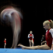 Young gymnasts train at the Sydney Olympic Park Sports Centre before the Australian Gymnastics Championships.