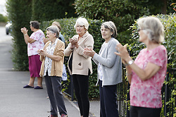 © Licensed to London News Pictures. 04/07/2020. Epsom, UK. Residents and staff show their appreciation as they join in the Clap for Carers celebration outside Epsom General Hospital in Surrey. The weekly celebration of NHS nurses, doctors and other key staff took place during 10 weeks of lockdown and ended on 28 May. Today is a special one off event for the 72nd anniversary of the founding of the National Health Service. Photo credit: Peter Macdiarmid/LNP
