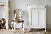 Interior shot of white themed home by Jonathan Bowcott. Fashionably called Shabby Chic.