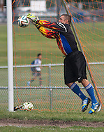 Goshen, New York -  A goalie makes a save at the Sweitzer Cup benefit men's soccer tournament on Aug. 2, 2014.