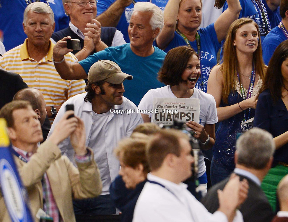 Apr 2, 2012; New Orleans, LA, USA; Film actress Ashley Judd (right) and Indycar driver Dario Franchitti (left) celebrate after the Kentucky Wildcats defeated the Kansas Jayhawks 67-59 in the finals of the 2012 NCAA men's basketball Final Four between the Kansas Jayhawks and Kentucky Wildcats at the Mercedes-Benz Superdome. Mandatory Credit: Derick E. Hingle-US PRESSWIRE