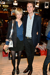 EDIE CAMPBELL and OTIS FERRY at the Roger Vivier 'The Perfect Pair' Frieze cocktail party celebrating Ambra Medda & 'Miss Viv' at the Roger Vivier Boutique, Sloane Street, London on 15th October 2014.