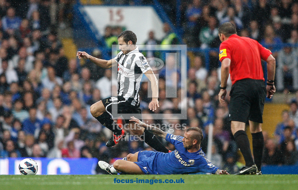 Picture by Andrew Tobin/Focus Images Ltd +44 7710 761829. 25/08/2012.  Yohan Cabaye of Newcastle jumps over the challenge of Raul Meireles of Chelsea during the Barclays Premier League match at Stamford Bridge, London.