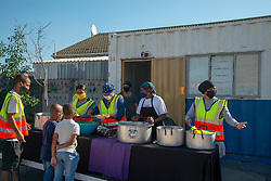 """A special chicken lunch is served by the Parkwood Community Upliftment (PCU) project, in Parkwood, Cape Town, South Africa, on Sunday, May 31, 2020. The youth organization, which normally feeds children as part of an after-school care program, has been feeding children and the elderly, and many other hungry people, in this poverty-stricken area in the Cape Flats since lockdown started more than two months ago. As the nation moves down to Level 3, on June 1st, CPU founder Max Amansure says the organization will continue to feed people. Often it's """"only"""" bread as the organization doesn't have any regular funding. However, as the area has been hard hit by COVID-19, Amansure says he wishes Parkwood could have remained on Level 5 Lockdown. PHOTO: EVA-LOTTA JANSSON"""