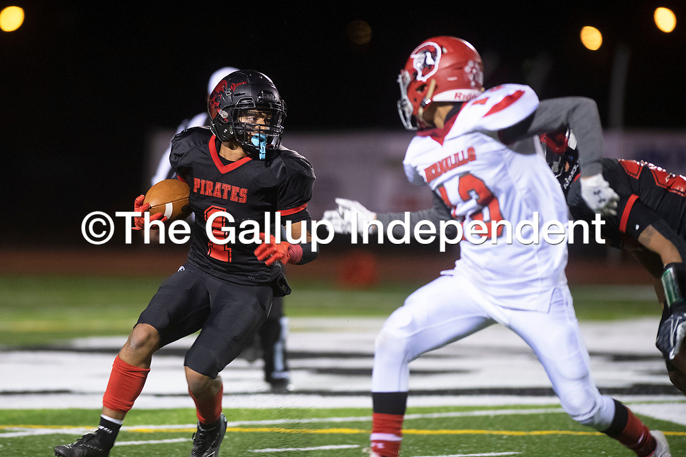 Grants Pirates' Terrell Hocker (1) carries the ball against  Bernalillo Spartans Friday night in Grants. The Pirates beat the Spartans 44-0.