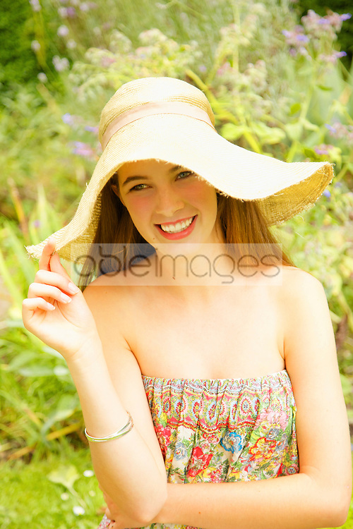 Smiling Teenage Girl Wearing Straw Hat