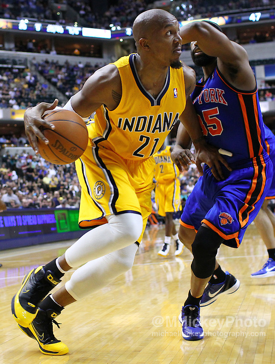 April 03, 2012; Indianapolis, IN, USA; Indiana Pacers power forward David West (21) dribbles along the baseline as New York Knicks point guard Baron Davis (85) applies defense at Bankers Life Fieldhouse. Mandatory credit: Michael Hickey-US PRESSWIRE