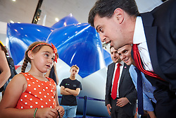 © Licensed to London News Pictures.  19/07/2014. Milton Keynes, UK. Labour leader ED MILIBAND speaks to 7 year old Amore Gaskin during a visit to the Centre:MK shopping centre in Milton Keynes. Photo credit: Cliff Hide/LNP