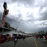 The garage area is crowded as a thunderstorm moves in during the first practice session of the 56th Annual NASCAR Coke Zero400 race at Daytona International Speedway on Thursday, July 3, 2014 in Daytona Beach, Florida. (AP Photo/Alex Menendez)