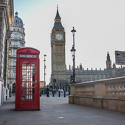 London, UK - 25 December 2014: no tourists at one of the most photographed telephone booths in London on early Christmas morning.