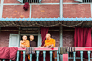 12 JUNE 2013 - YANGON, MYANMAR:   Buddhist monks on the balcony of their living quarters near a temple in Yangon, Myanmar. Most young men in Myanmar enter the clergy (called the Sangha) at least once in their life. Sometimes for only a few weeks or a month, other times for years.         PHOTO BY JACK KURTZ