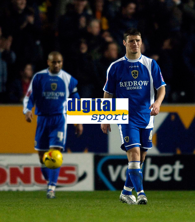 Photo: Jed Wee.<br />Hull City v Cardiff City. Coca Cola Championship.<br />03/12/2005.<br />Cardiff's Jason Koumas (R) pulls a face in frustration after they concede their first goal.